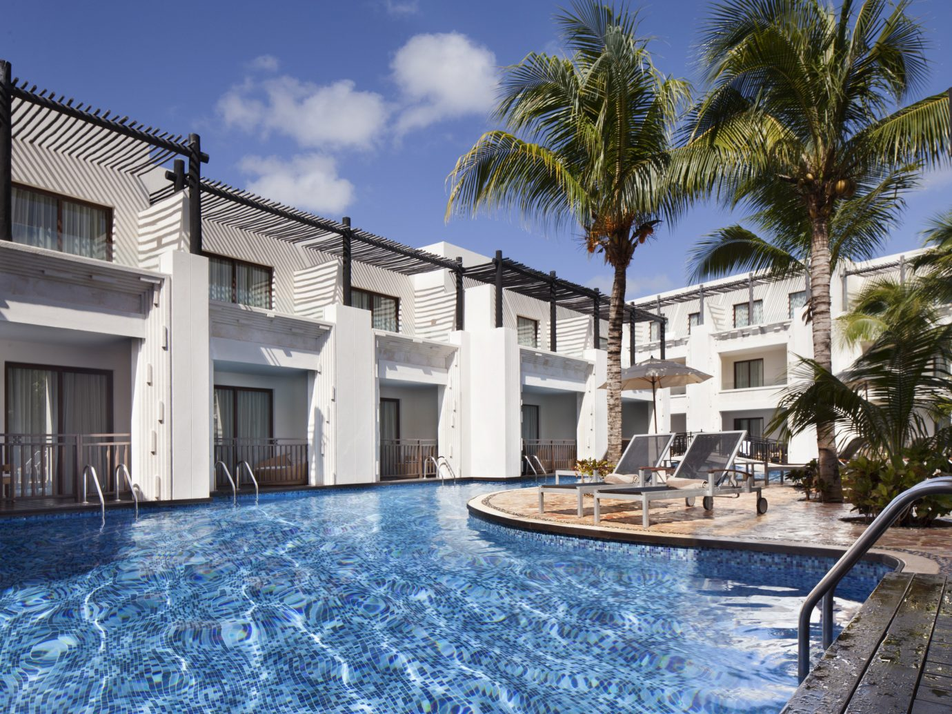 Hotels outdoor sky water property swimming pool Resort Pool real estate home Villa estate apartment condominium hotel house mansion building palm tree arecales leisure facade window hacienda vacation swimming