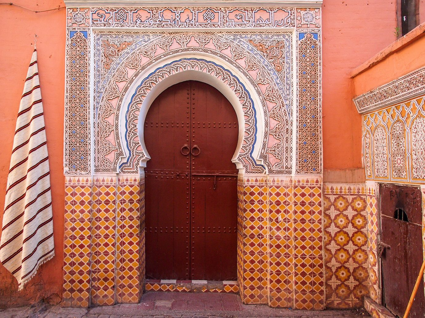 Offbeat color outdoor building wall Architecture arch brick facade palace ancient history interior design temple place of worship synagogue orange colored