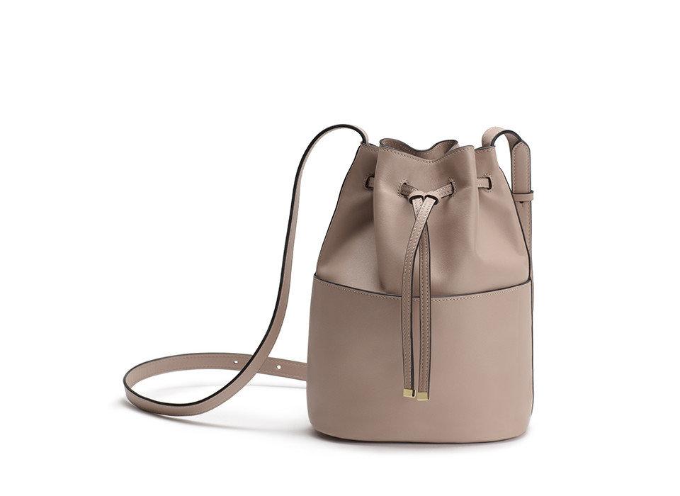 Style + Design white indoor bag shoulder bag handbag fashion accessory product beige leather product design accessory brand bottle