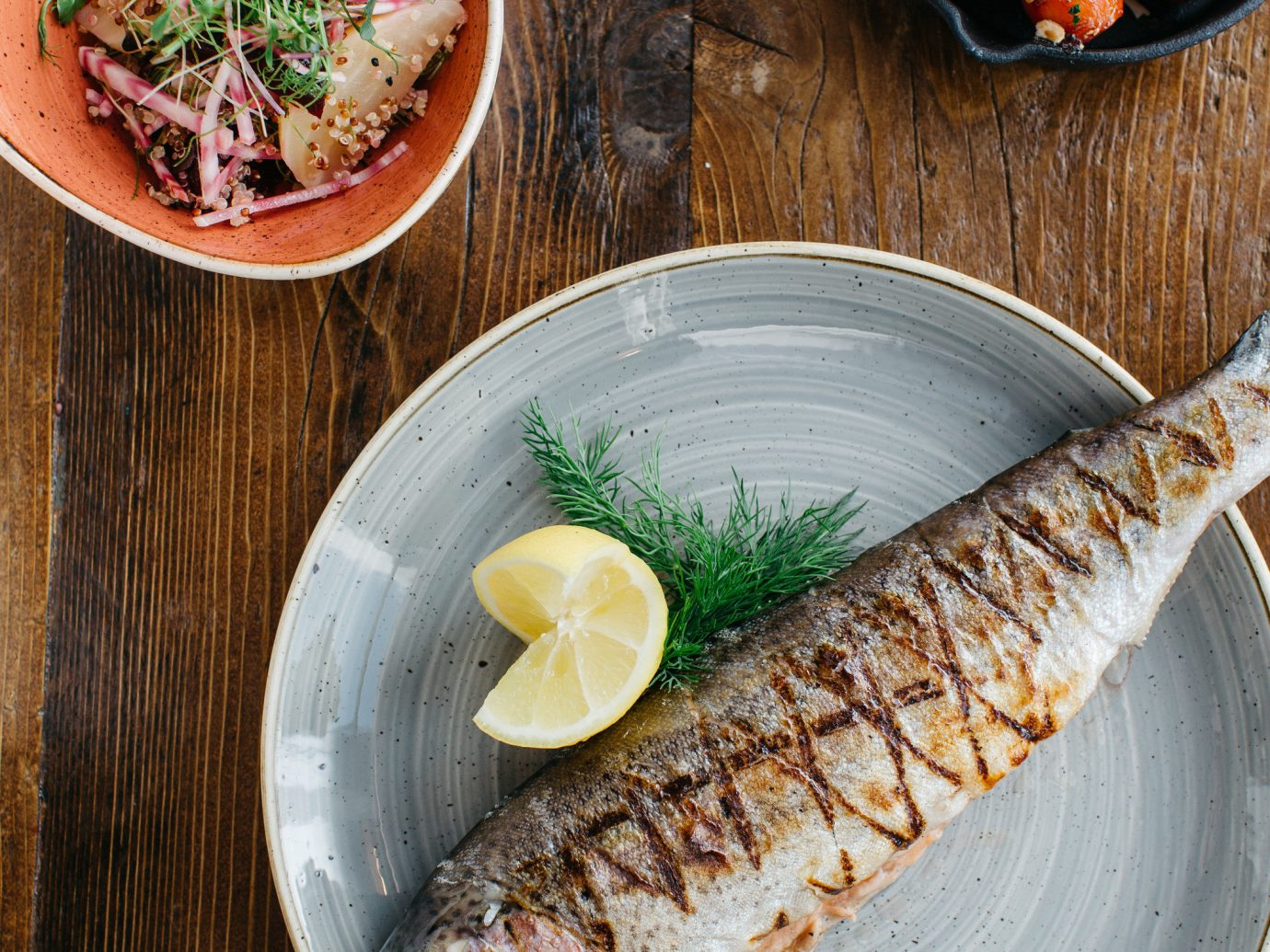 Romance Trip Ideas plate table food wooden dish fish sardine produce forage fish meat cuisine vegetable herring slice meal sliced