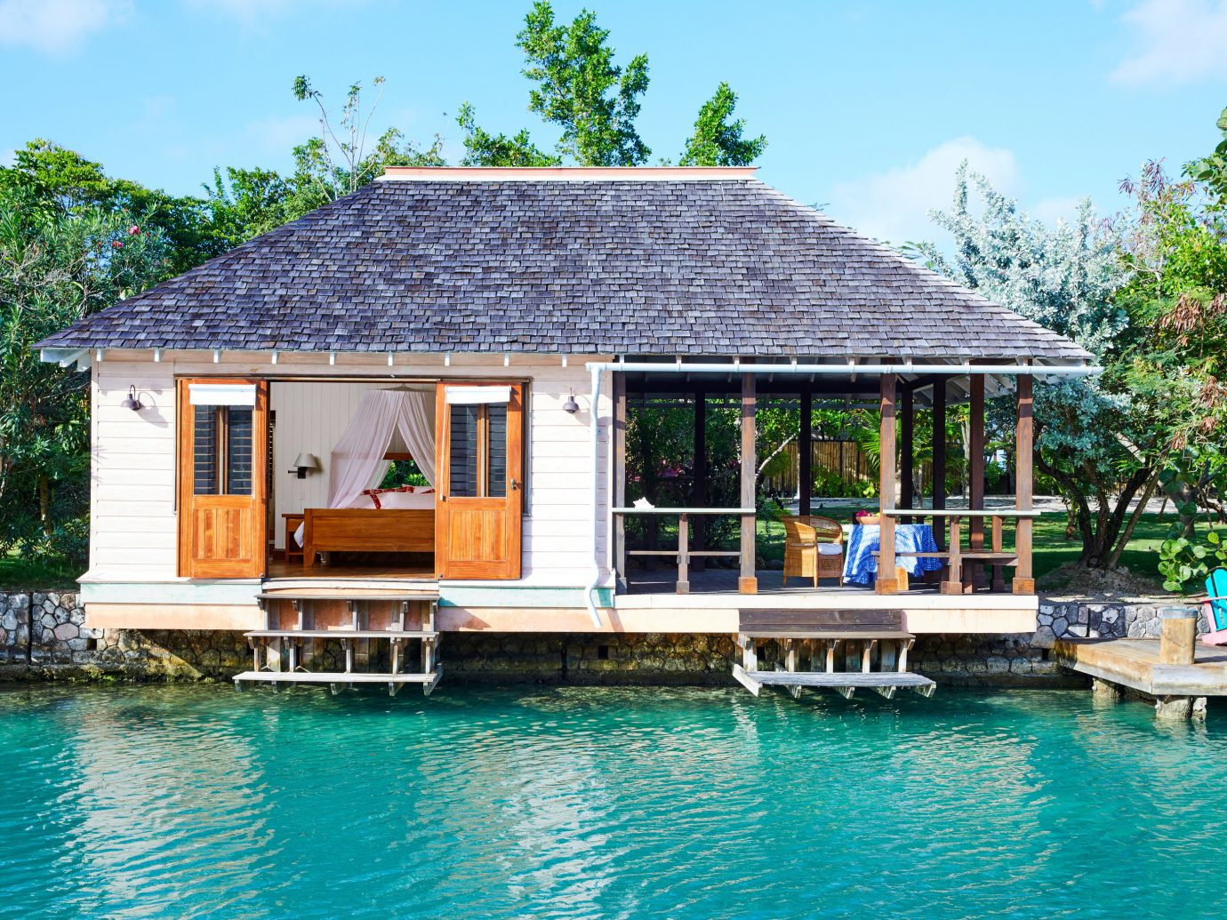 Trip Ideas outdoor sky water tree building house property Resort cottage swimming pool Villa real estate estate home leisure green outdoor structure gazebo surrounded