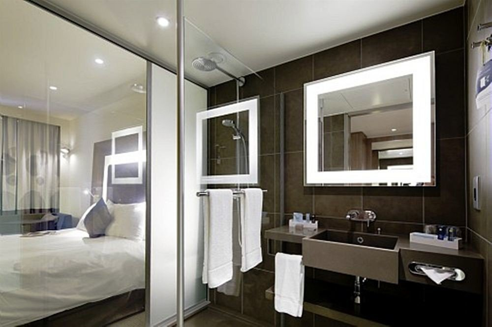 bathroom mirror property condominium home Suite sink Modern