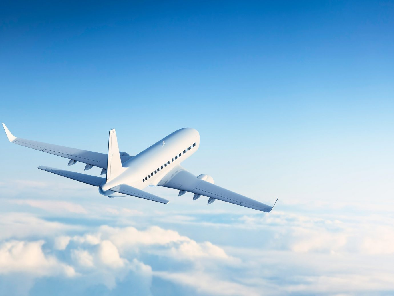 Travel Tips sky plane outdoor flying airline airplane air travel vehicle transport aircraft aviation air atmosphere of earth airliner cloudy flight aerospace engineering jet takeoff wide body aircraft clouds wing blue boeing 777 high land day