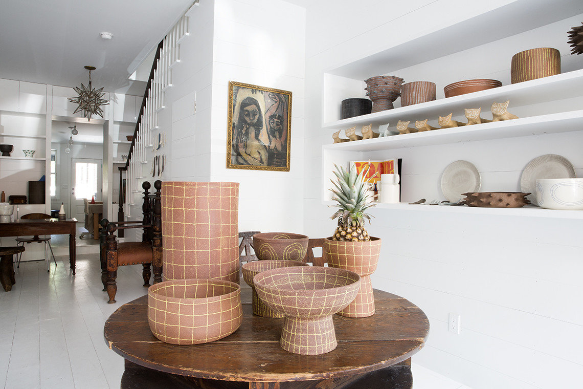 art pineapple pottery Style + Design indoor room property interior design floor living room home wood Design furniture several