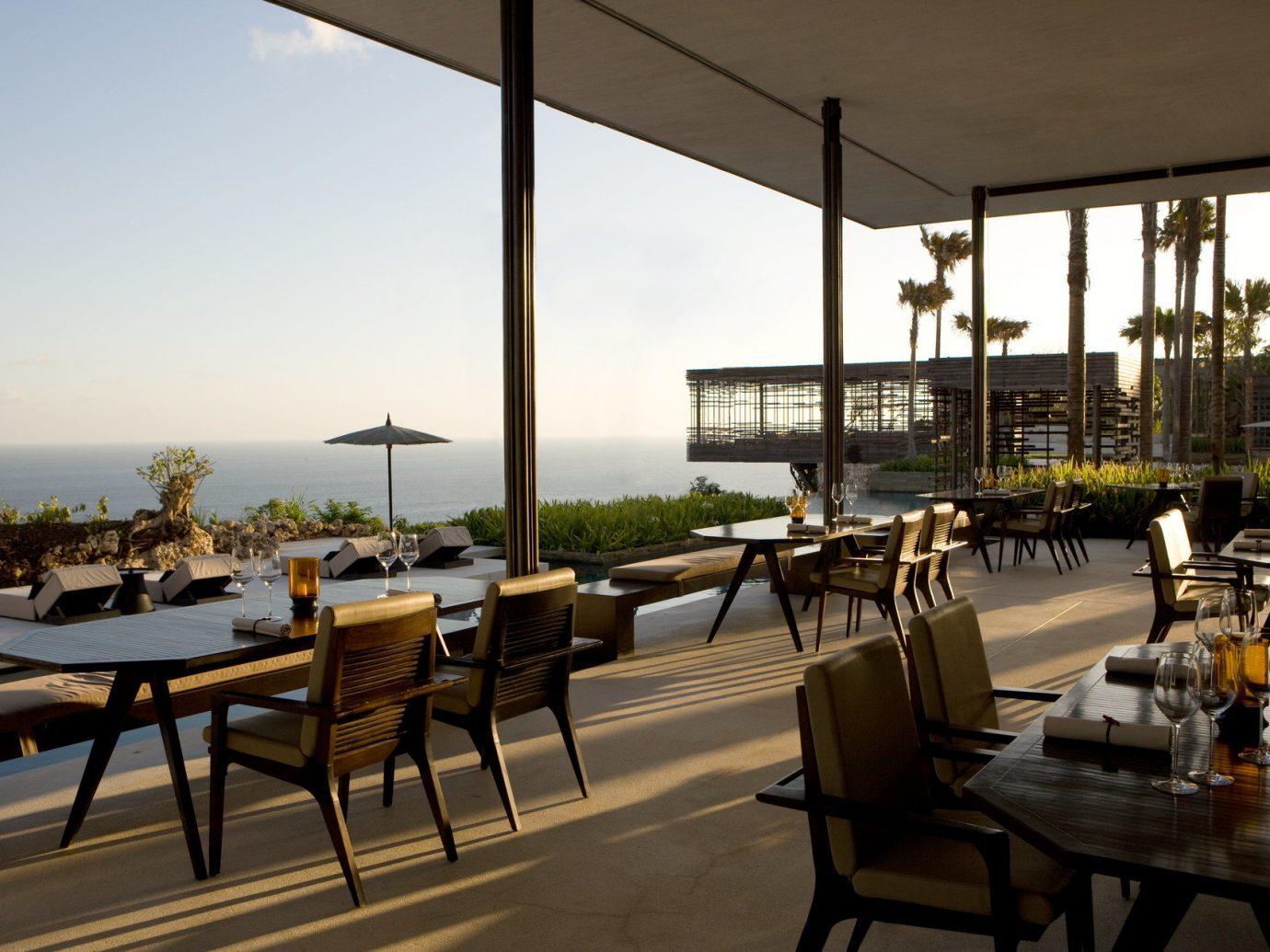 Health + Wellness Hotels sky table chair property restaurant Resort estate interior design condominium Villa Bar overlooking furniture set several