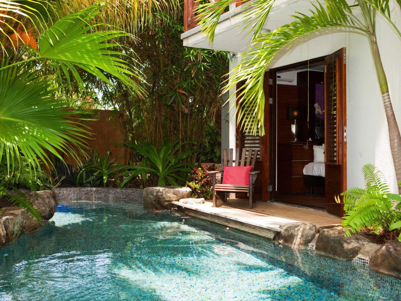 Boutique Hotels Living Lounge Luxury Modern Pool Romantic Getaways Romantic Hotels Tropical tree water swimming pool plant property Resort backyard vacation estate Villa real estate arecales eco hotel condominium palm swimming
