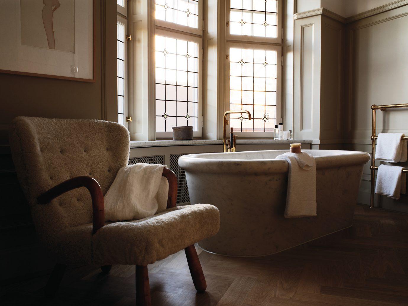 Design Hotels Stockholm Sweden window floor indoor room furniture interior design table home flooring wood chair living room house tub tan