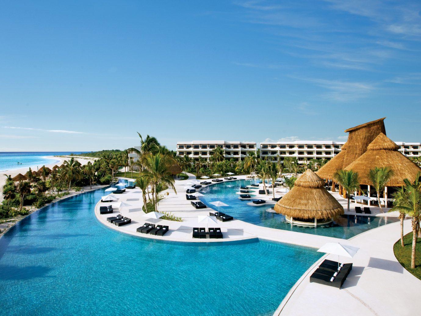 All-Inclusive Resorts Hotels Romance sky Resort outdoor property resort town swimming pool leisure estate real estate tourism vacation blue hotel caribbean Sea condominium tropics Lagoon Villa Island