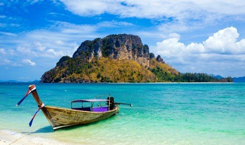 Jetsetter Guides water sky outdoor Boat Beach long tail boat caribbean Sea vacation bay watercraft rowing Ocean Island blue boating Coast vehicle shore Lake islet day sandy tied