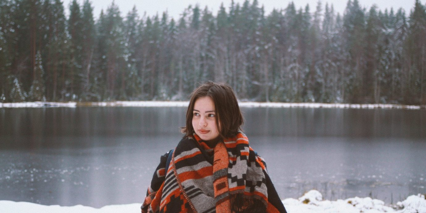 Hotels Travel Shop Trip Ideas outdoor tree sky water person Winter snow freezing Lake girl ice fun Nature jacket vacation