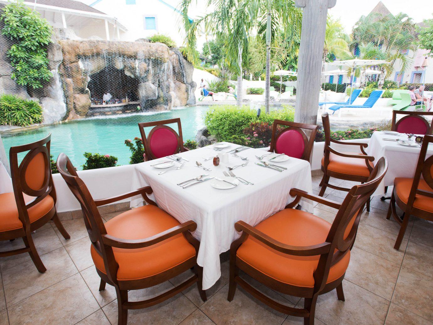 All-Inclusive Resorts Hotels floor chair table indoor property room estate restaurant real estate Villa Resort home interior design Dining furniture hacienda backyard area set dining table
