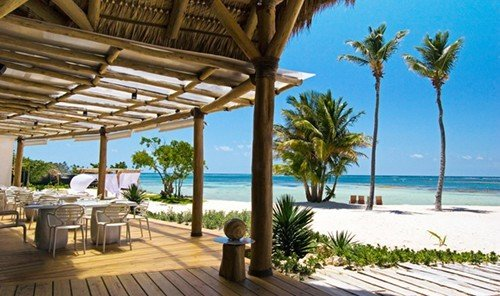Travel Tips outdoor Resort property building chair caribbean leisure palm vacation Ocean estate Villa Pool swimming pool real estate furniture eco hotel Beach overlooking Deck lined shade