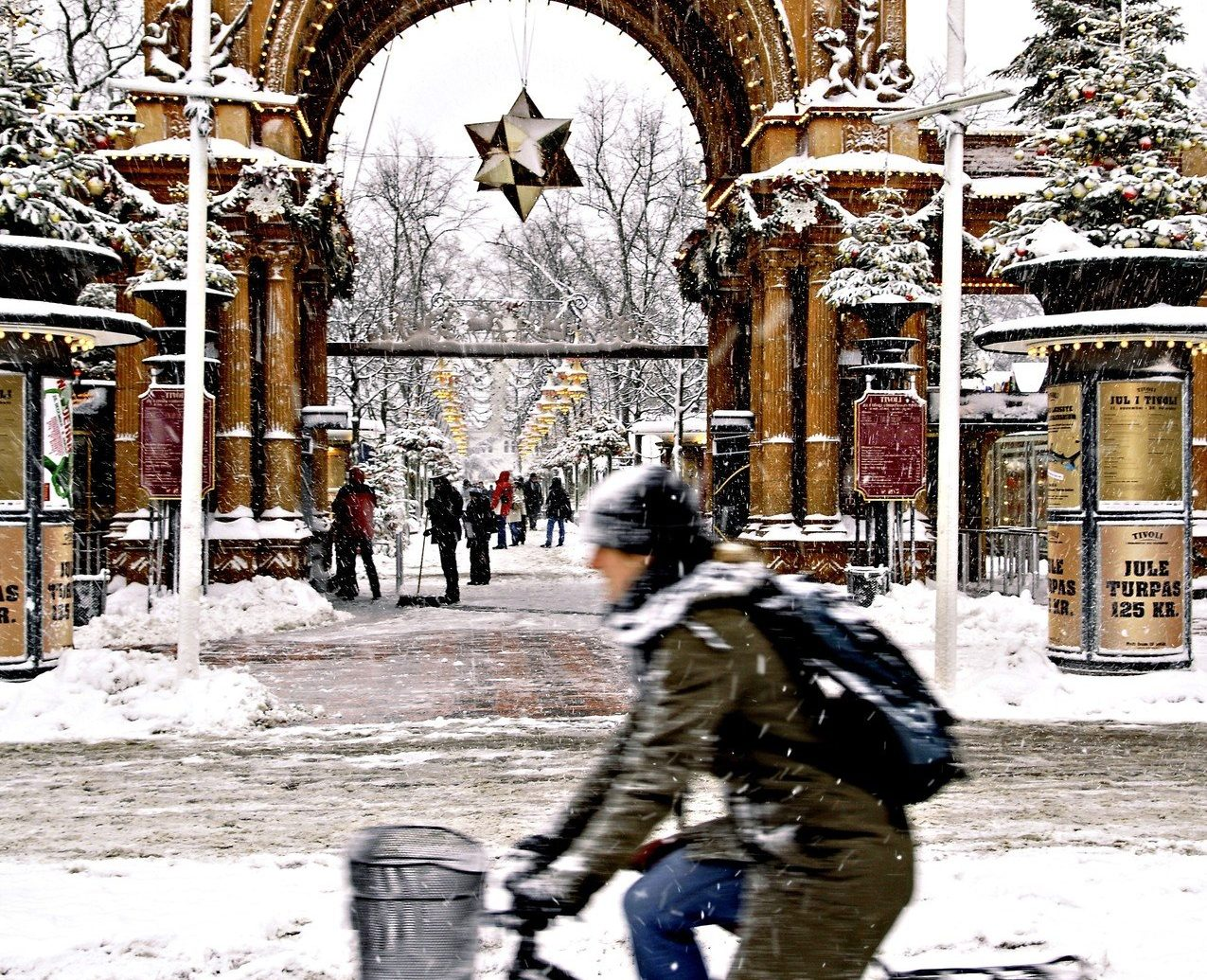 Trip Ideas outdoor building bicycle person man riding snow Winter weather season vehicle sports equipment