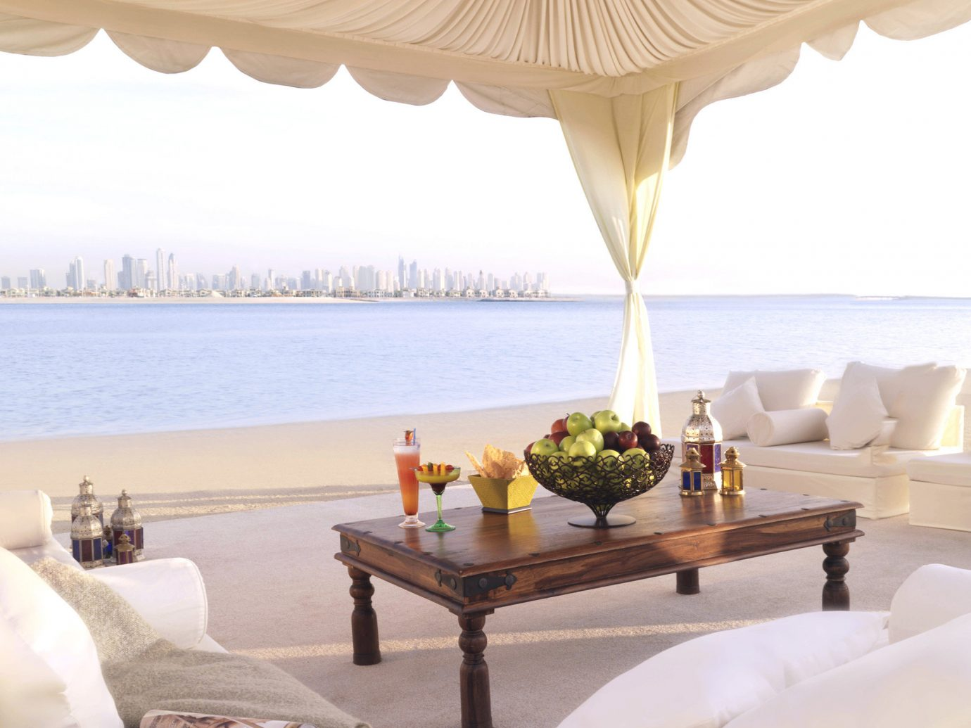 Drink Dubai Food + Drink Hotels Lounge Luxury Travel Middle East Resort Waterfront indoor room ceiling interior design living room table window covering several