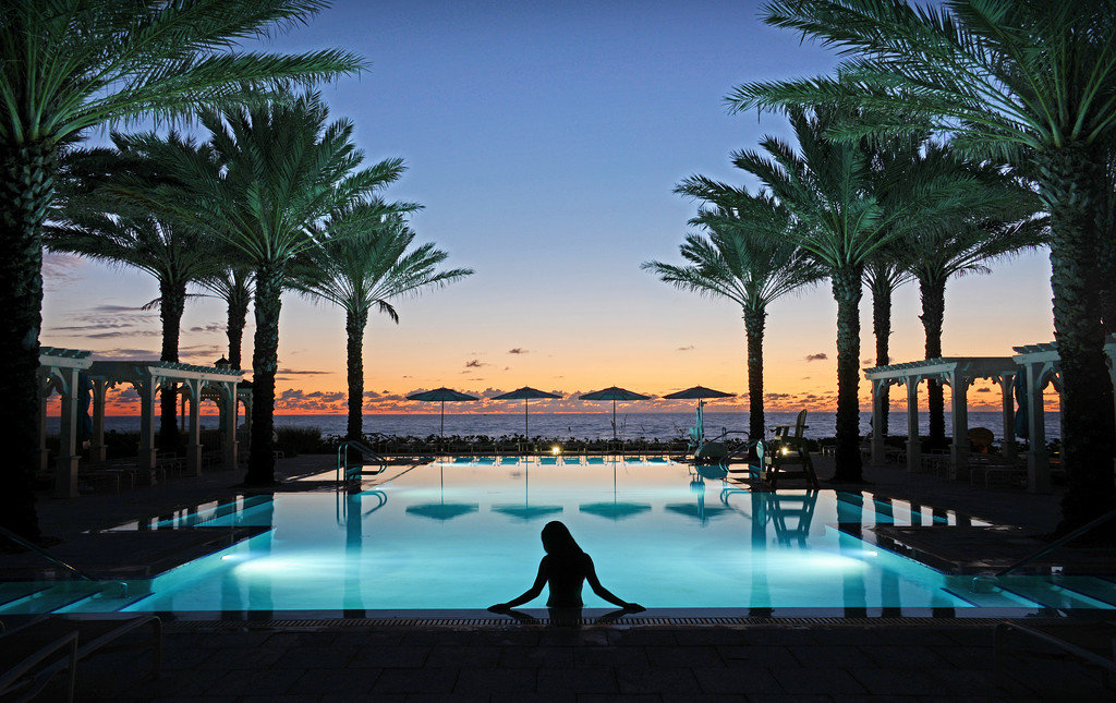 Hotels tree outdoor water palm leisure swimming pool Resort Pool vacation arecales estate Beach tropics Sea palm family swimming lined