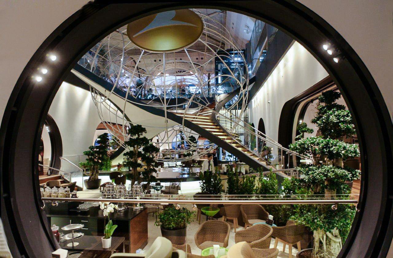 Arts + Culture Hotels Jetsetter Guides mirror indoor reflection interior design glass window round