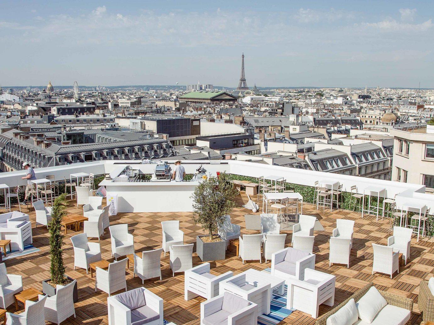 Food + Drink Paris Trip Ideas sky outdoor urban area City roof real estate tourism outdoor structure Sea