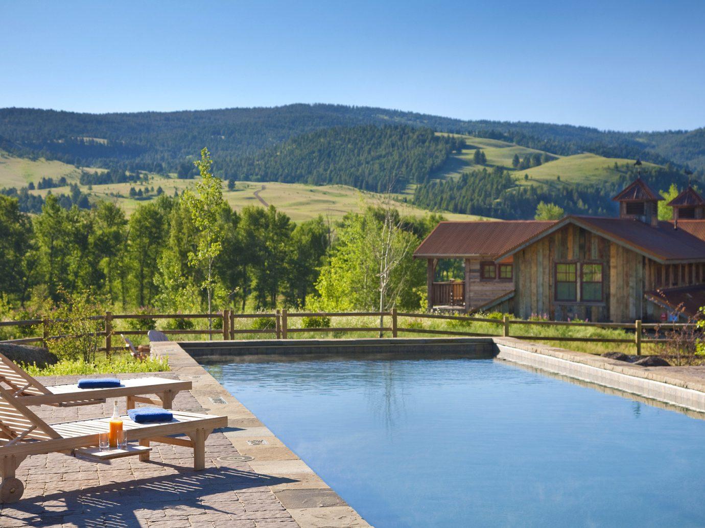 All-Inclusive Resorts Hotels Romance outdoor mountain water property swimming pool estate Nature real estate Villa cottage Resort backyard Lake Island shore