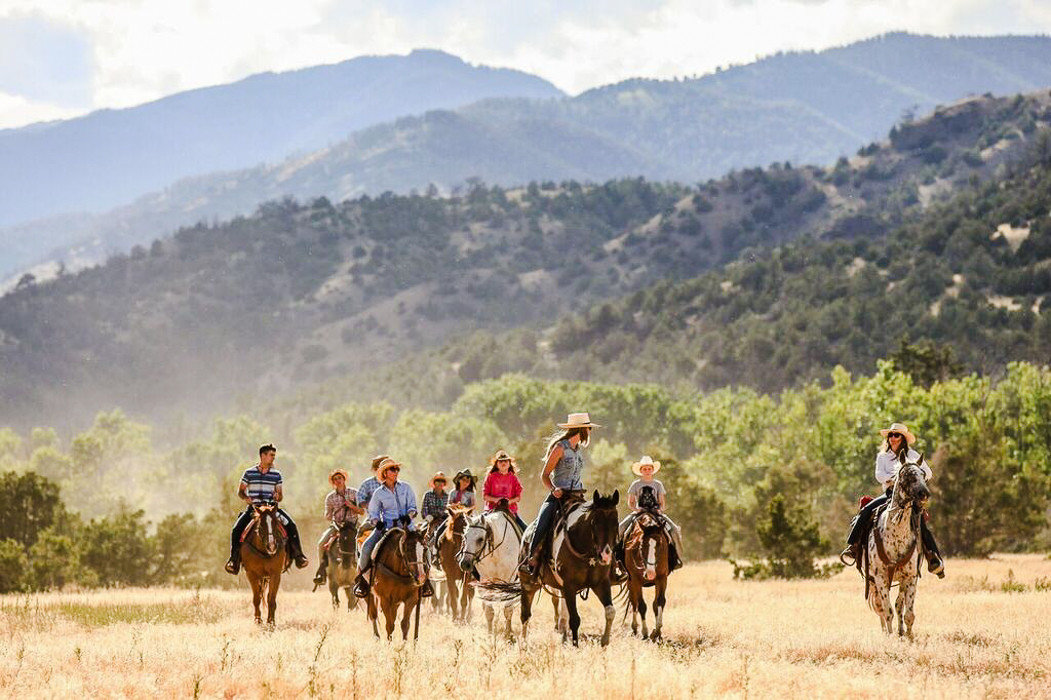 Glamping Hotels Montana Outdoors + Adventure Trip Ideas ecosystem Ranch grassland trail riding horse pack animal ecoregion steppe mountain landscape horse like mammal pasture Adventure mustang horse tourism prairie tree mare