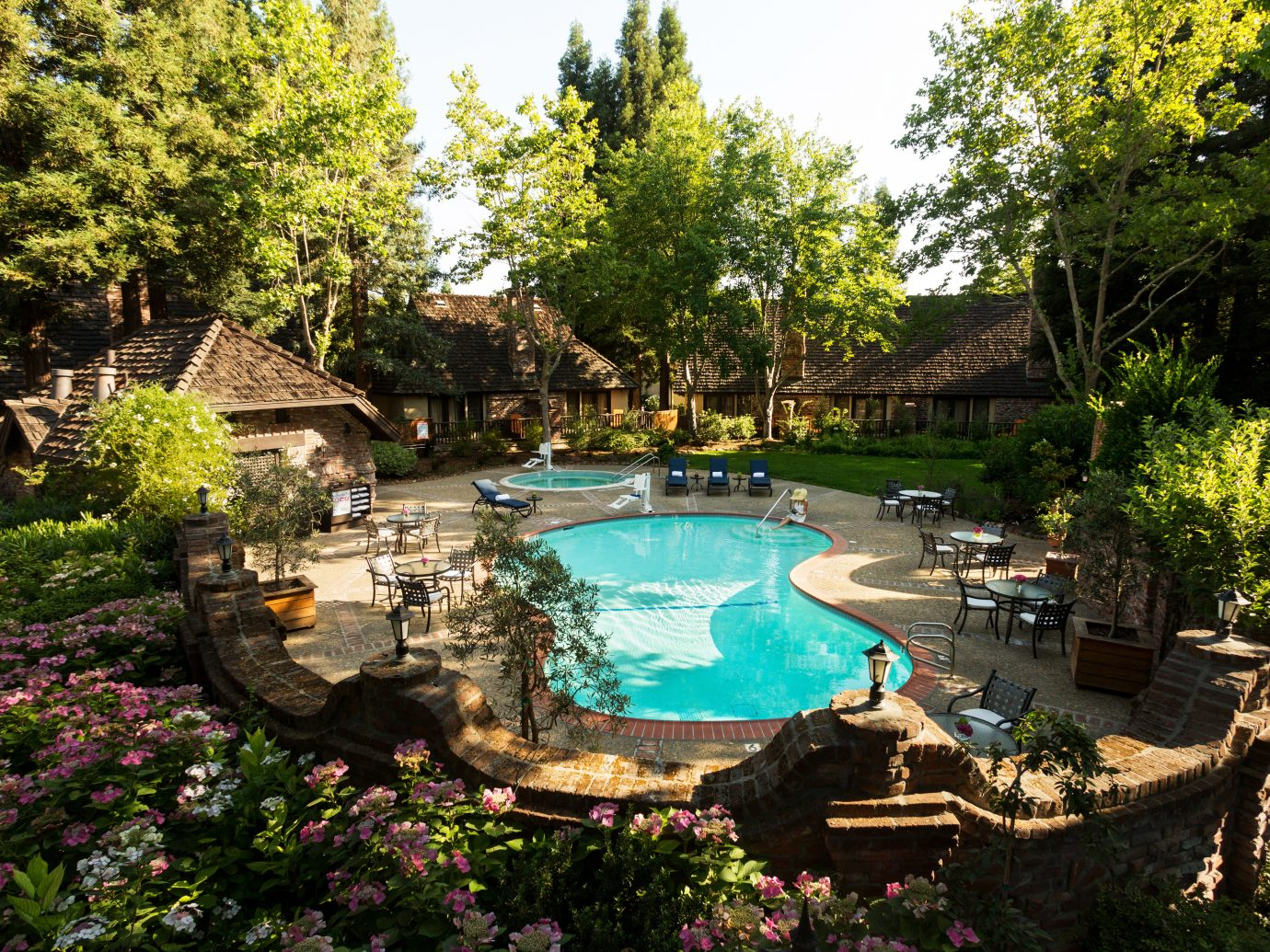 Grounds Health + Wellness Hotels Inn Patio Pool Romantic Spa Retreats Terrace Trip Ideas tree outdoor swimming pool estate Garden backyard Resort pond botanical garden yard mansion plant area surrounded several day