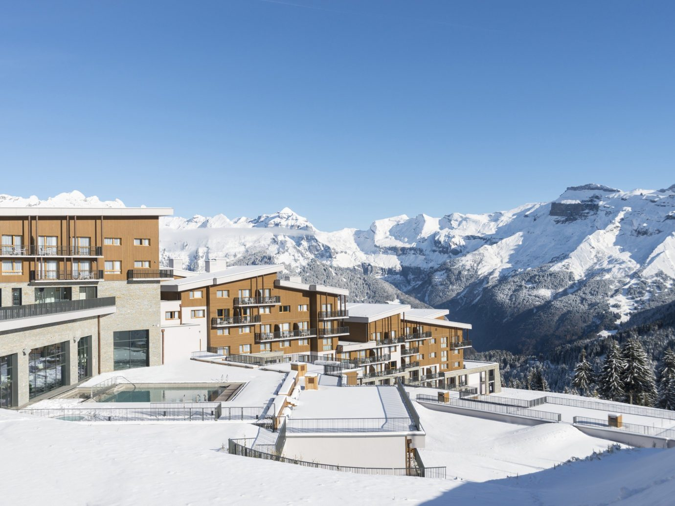 All-Inclusive Resorts Family Travel Hotels Winter mountain range snow property home sky alps mountain piste real estate elevation house apartment ski resort glacial landform roof