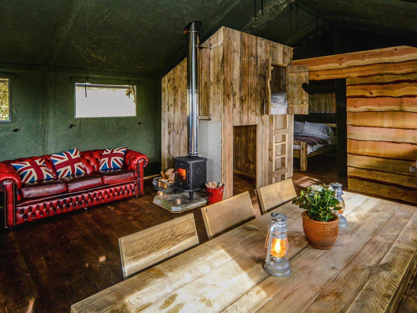 Glamping Outdoors + Adventure Trip Ideas indoor floor Living room interior design living room home real estate house wood log cabin furniture stone
