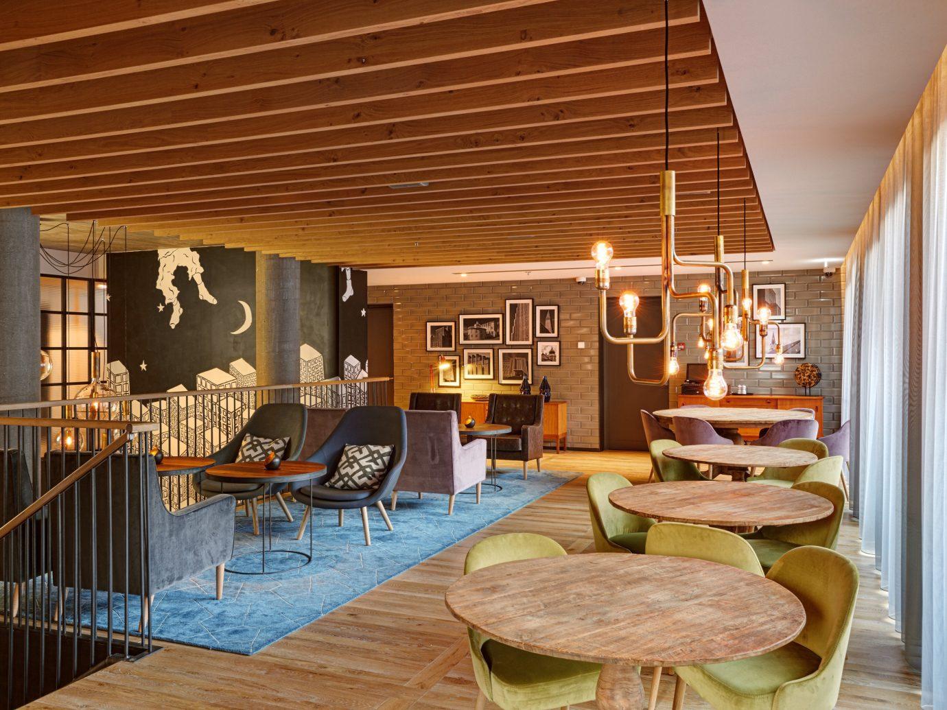 Hotels Iceland indoor floor chair room property building Living living room dining room home interior design estate hardwood wood wooden cottage real estate Resort farmhouse ceiling furniture