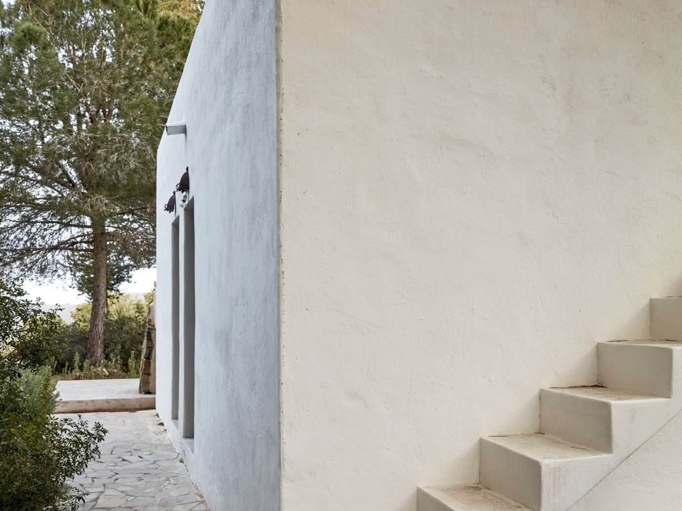 Boutique Hotels Hotels Luxury Travel Meditation Retreats Spa Retreats Trip Ideas Yoga Retreats outdoor house building wall Architecture facade stone wood daylighting cement concrete material stair step