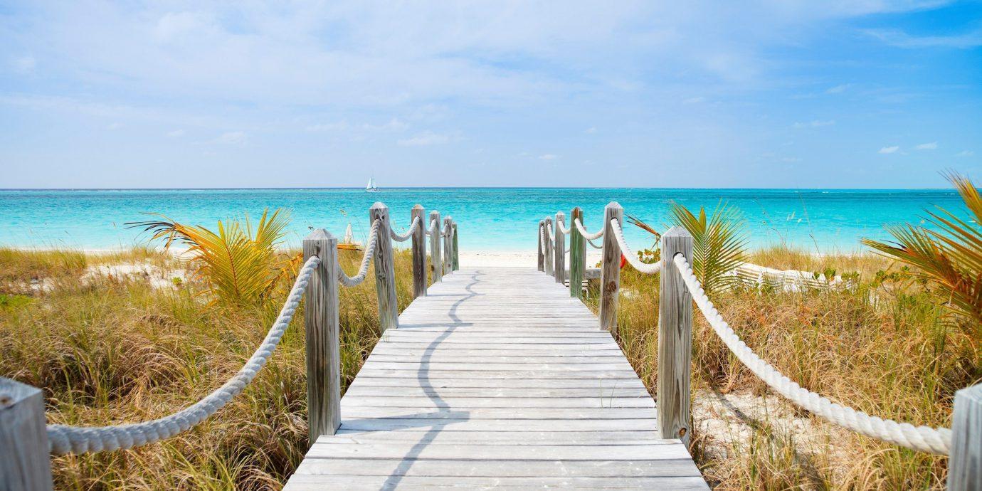 News water sky outdoor Ocean Beach shore Sea body of water Coast vacation horizon Pool walkway Nature sand caribbean arecales bay lawn overlooking Island cape sandy Deck swimming