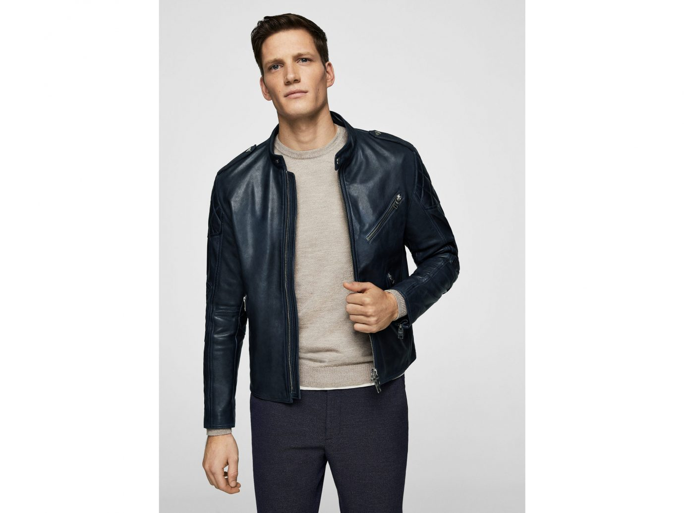 Packing Tips Style + Design Travel Shop person posing man suit standing clothing jacket leather jacket leather wearing black textile material sleeve dressed jeans trouser male