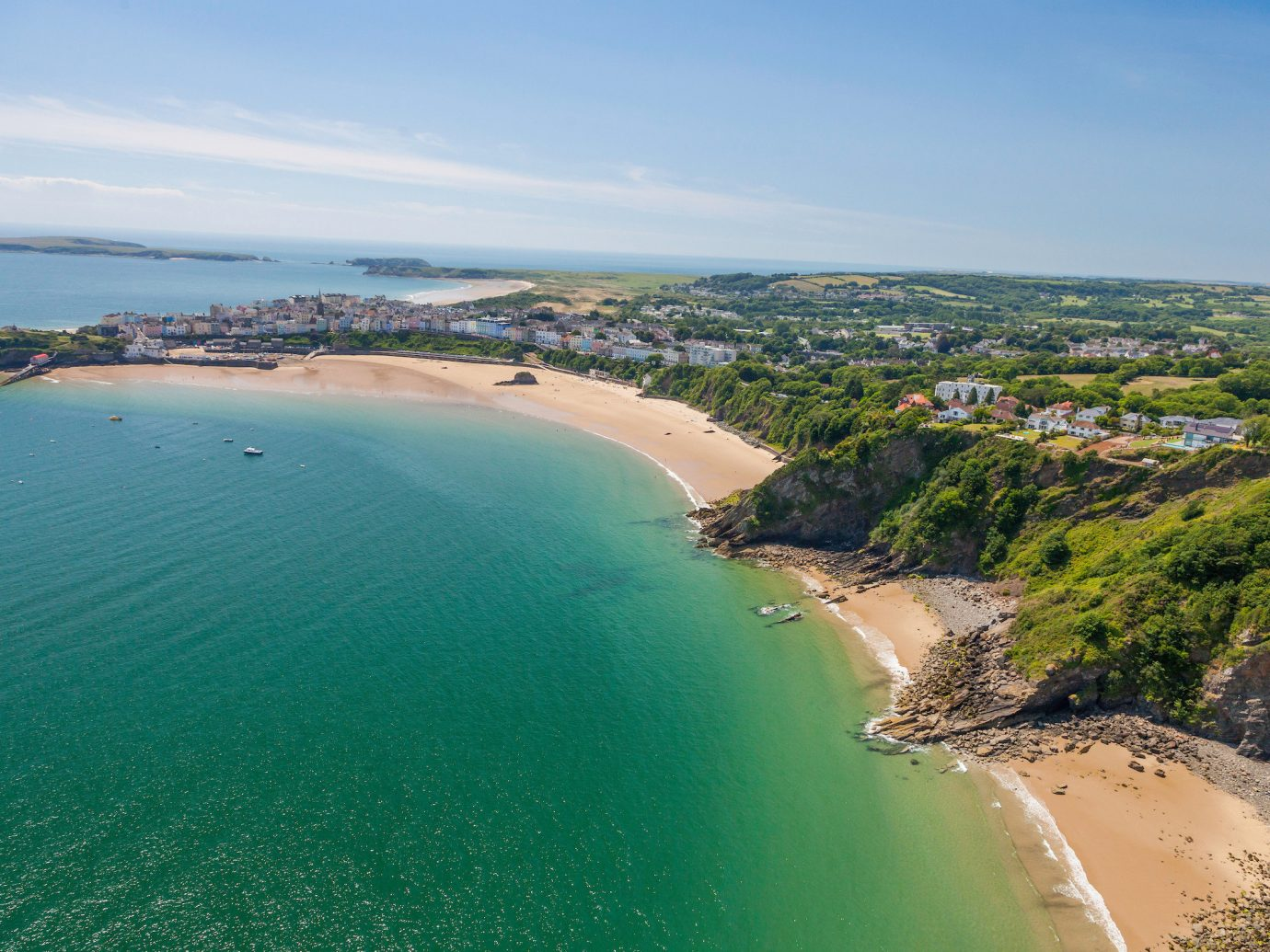 Jetsetter Guides outdoor sky water Nature Coast Ocean Sea body of water landform shore Beach horizon vacation aerial photography bay cape cliff reservoir terrain cove overlooking Island