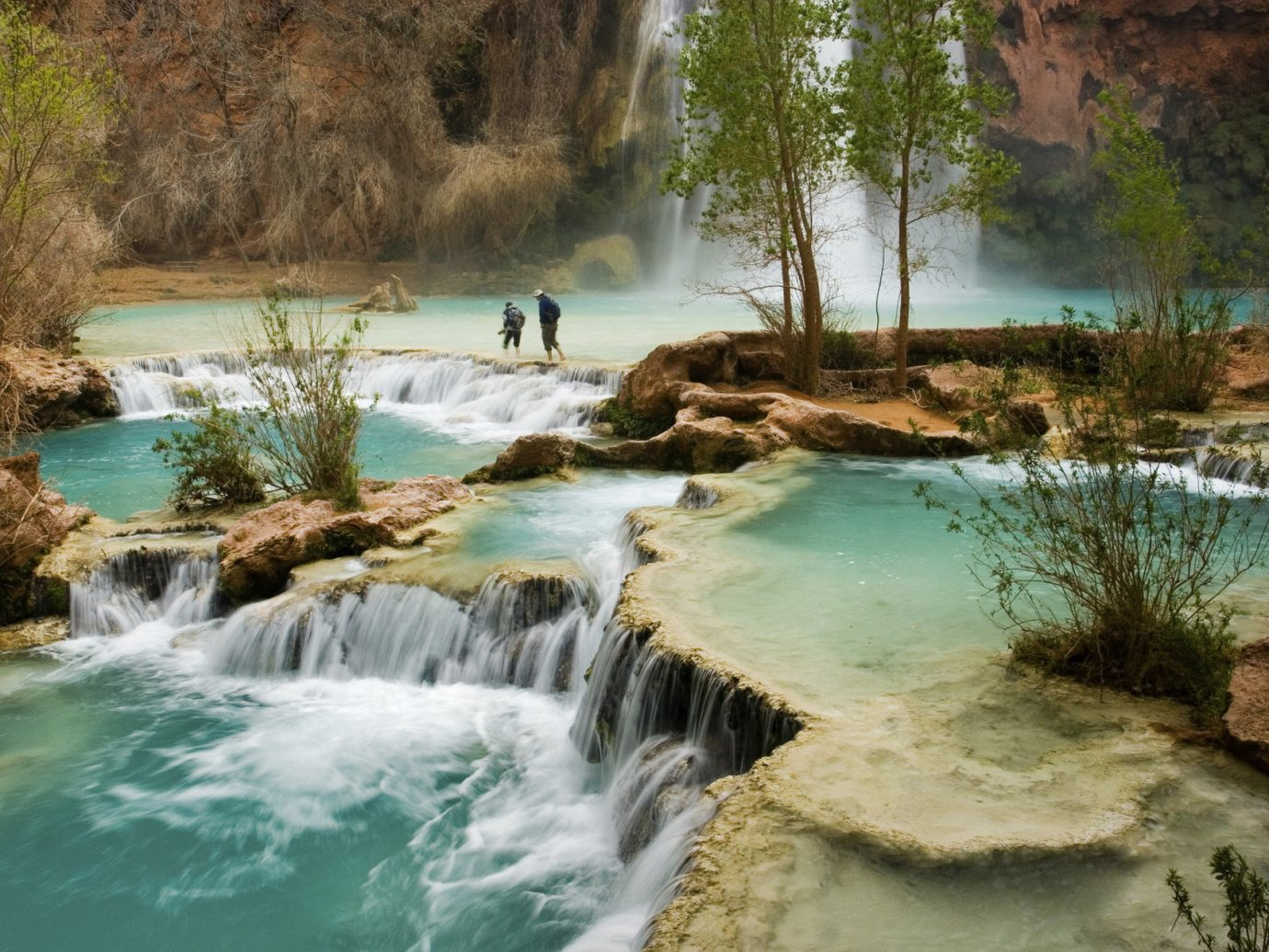 Lakes + Rivers Landmarks Trip Ideas tree water Nature outdoor Waterfall River body of water wilderness watercourse rapid stream water feature reflection rock landscape pond surrounded