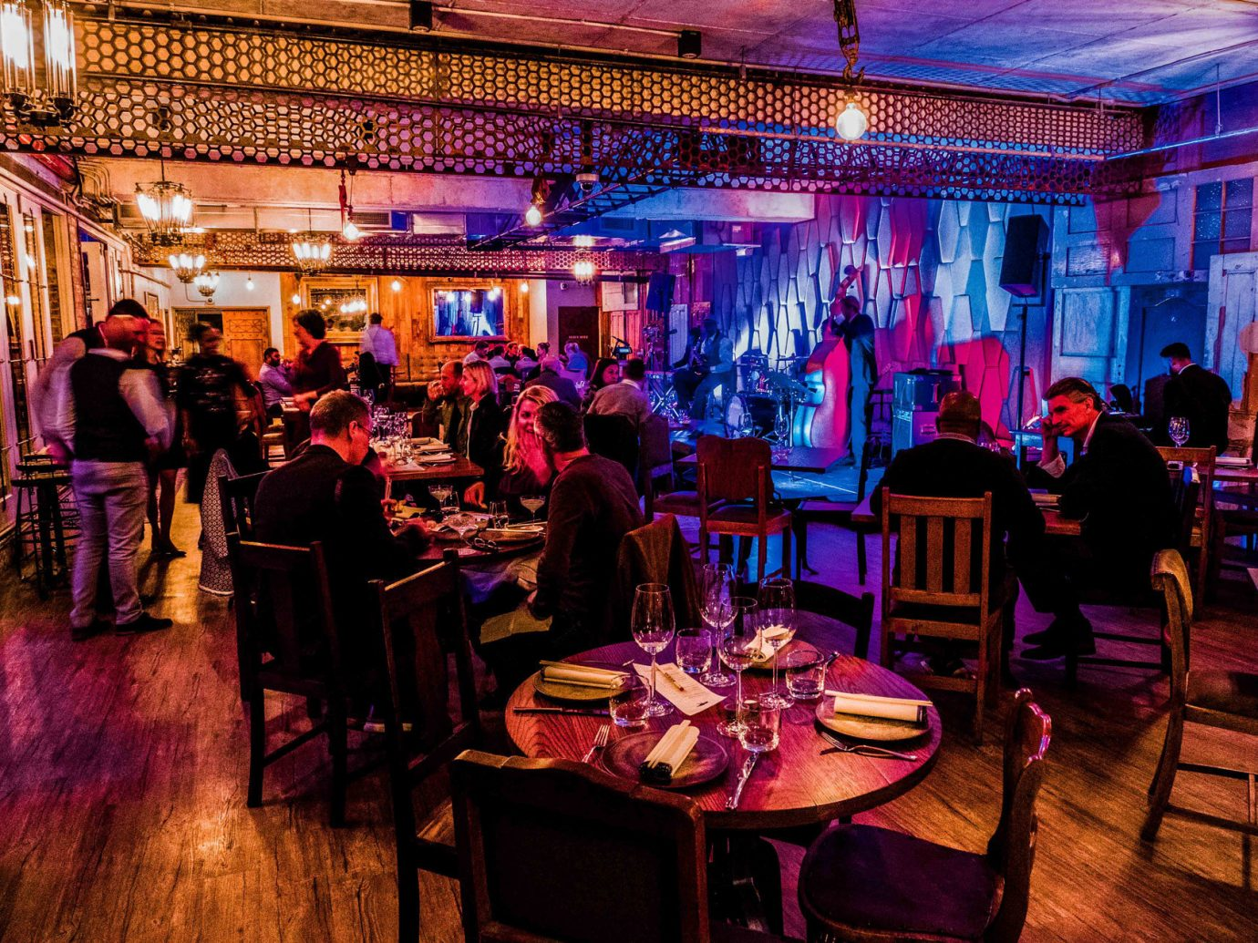 Arts + Culture Trip Ideas floor indoor function hall person purple restaurant people ceremony scene ceiling lighting wedding reception event ballroom Party group Bar banquet interior design several crowd