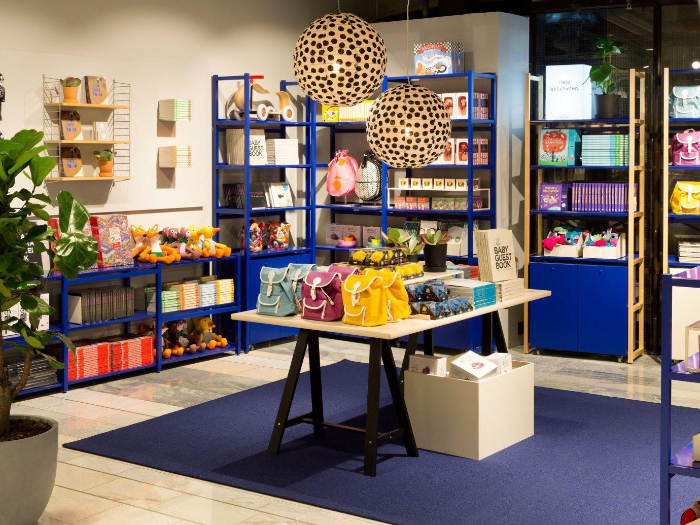 Style + Design indoor floor room building retail bookselling shelf art interior design Design library