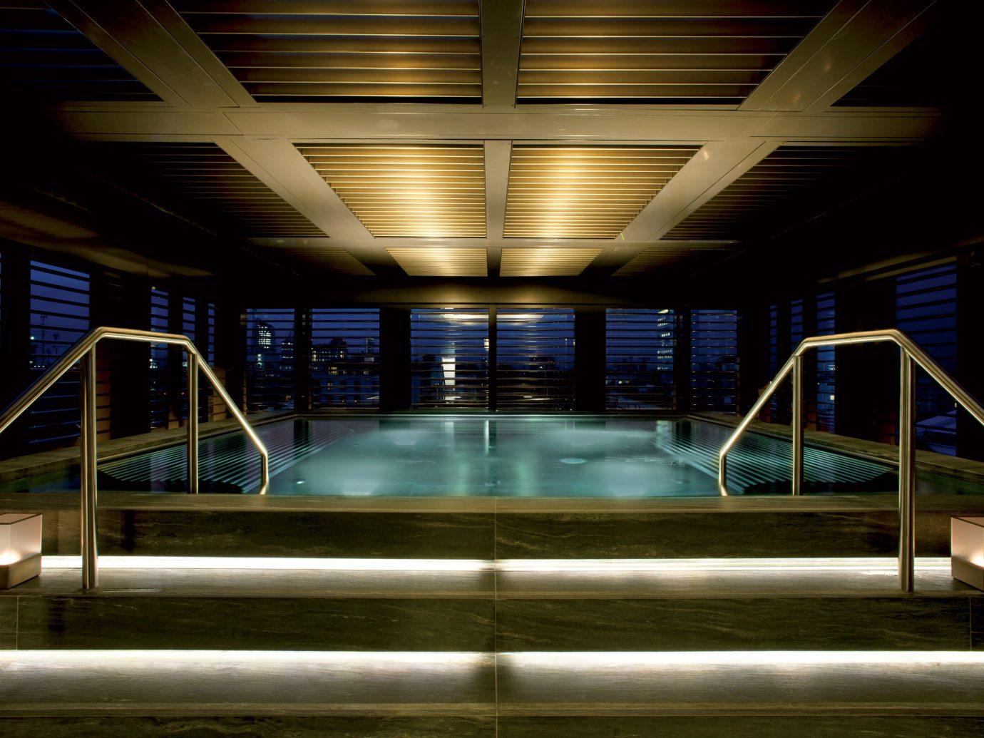 Elegant Hotels Italy Luxury Milan Pool Scenic views indoor ceiling night light reflection Architecture swimming pool lighting interior design subway