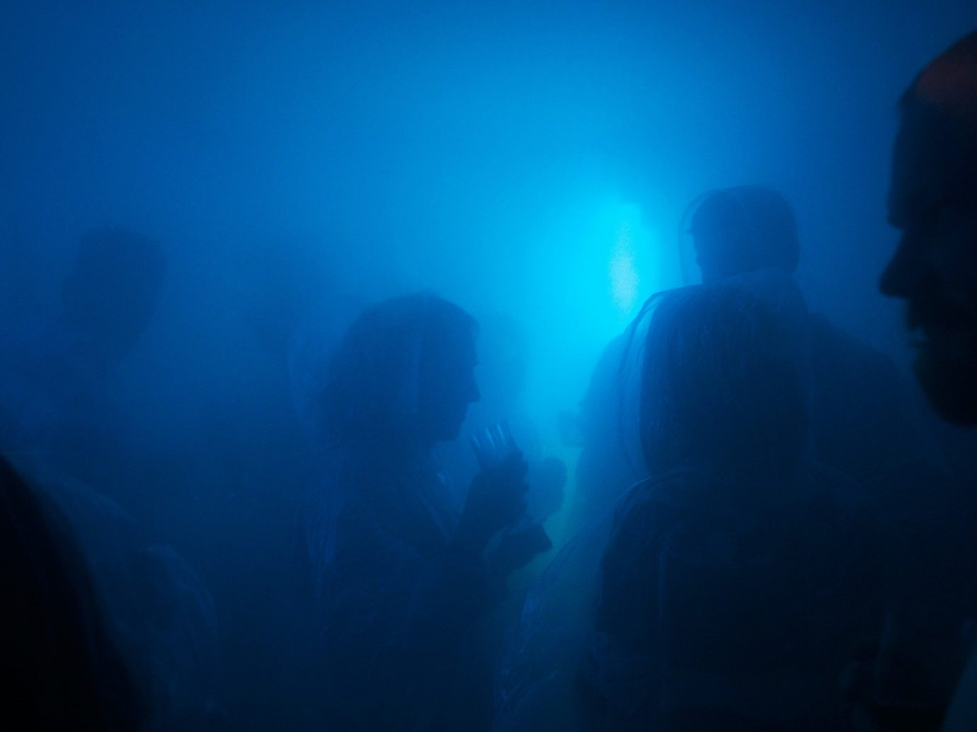 Arts + Culture person blue underwater dark ocean floor