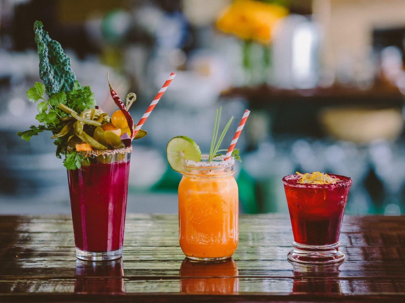 Trip Ideas table cocktail Drink alcoholic beverage glass food orange non alcoholic beverage mai tai produce singapore sling distilled beverage beverage