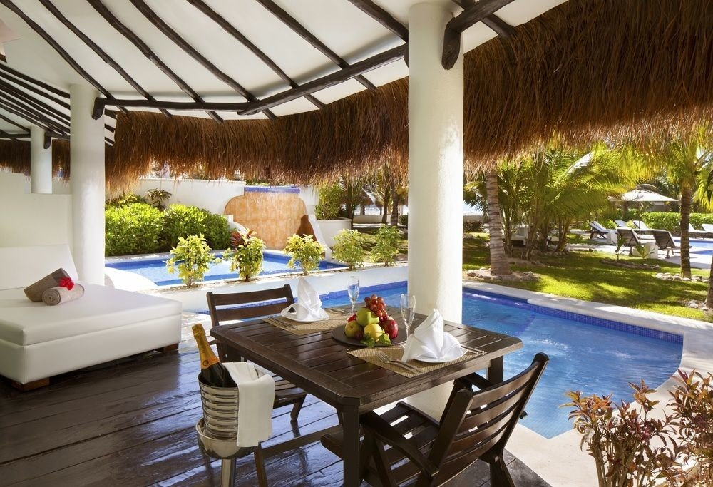 All-Inclusive Resorts Hotels Romance table property Resort estate Villa interior design real estate Patio outdoor structure vacation backyard hacienda living room swimming pool penthouse apartment porch Deck furniture