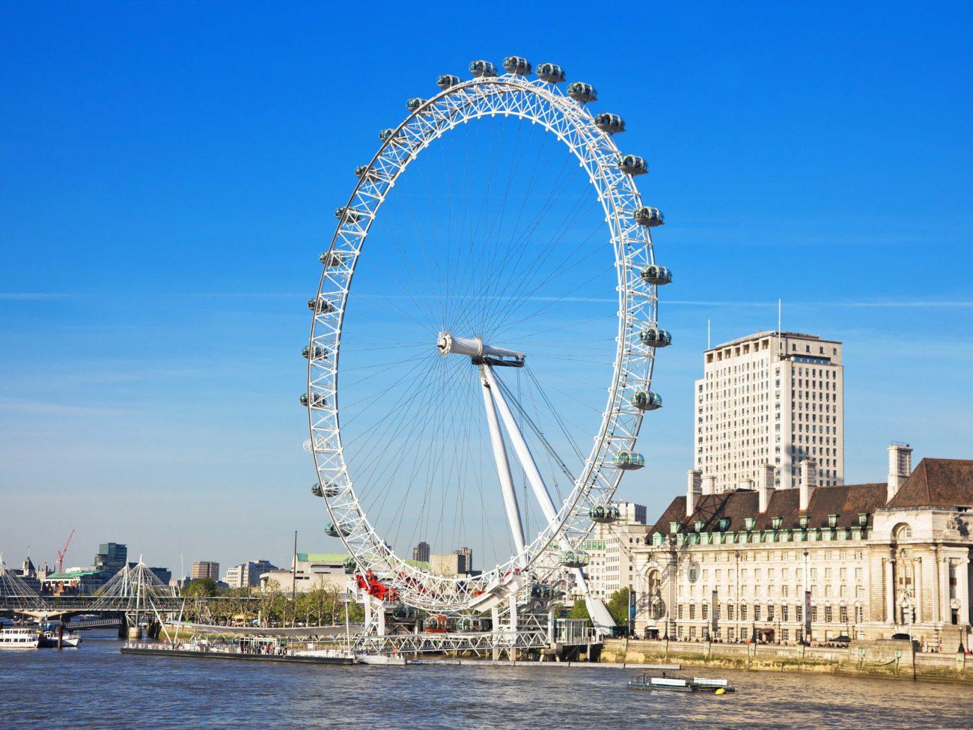 Budget sky outdoor ferris wheel landmark tourist attraction cityscape amusement park tower Sea arch ride