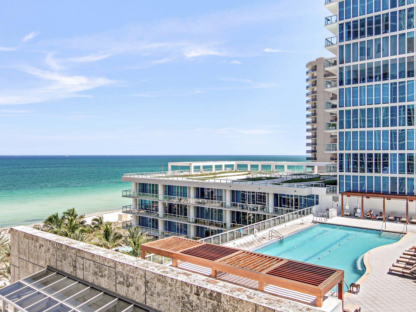 Beach Beachfront City Health + Wellness Hotels Luxury Ocean Romantic Yoga Retreats outdoor condominium property swimming pool Resort real estate facade estate apartment marina dock shore