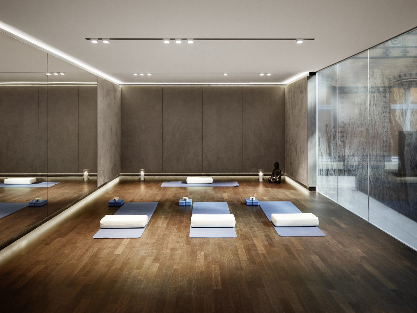 ambient lighting chic class clean Health + Wellness Hotels interior Luxury private relaxation Spa Retreats studio yoga indoor floor wall ceiling room interior design lighting recreation room Design wood flooring headquarters furniture Lobby