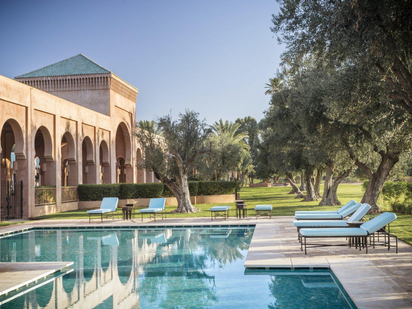 Hotels outdoor building leisure property swimming pool estate vacation reflecting pool bridge Villa palace mansion Resort backyard