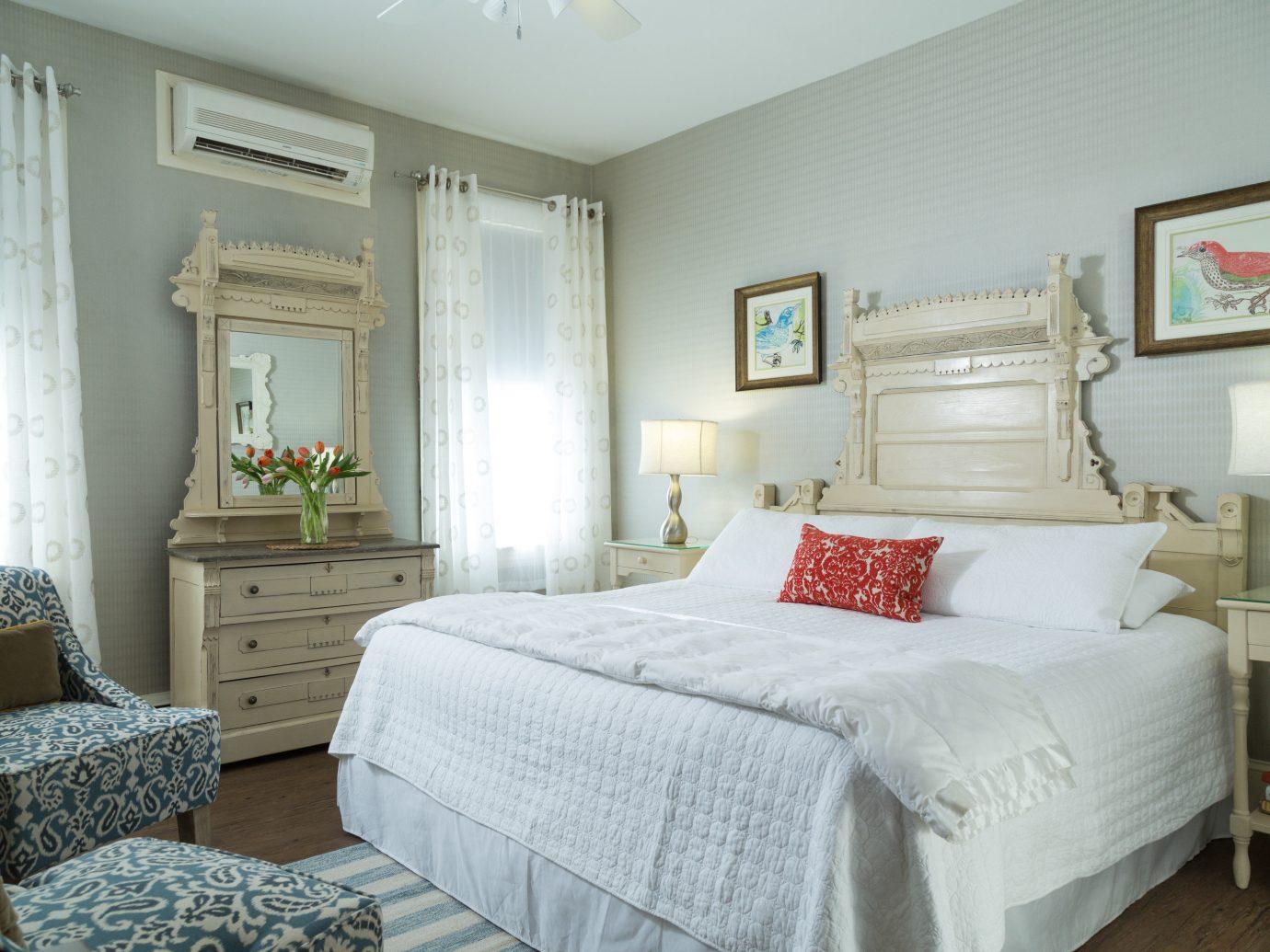Hotels indoor bed wall floor room Bedroom property ceiling home estate living room cottage real estate interior design hotel Suite furniture bed sheet