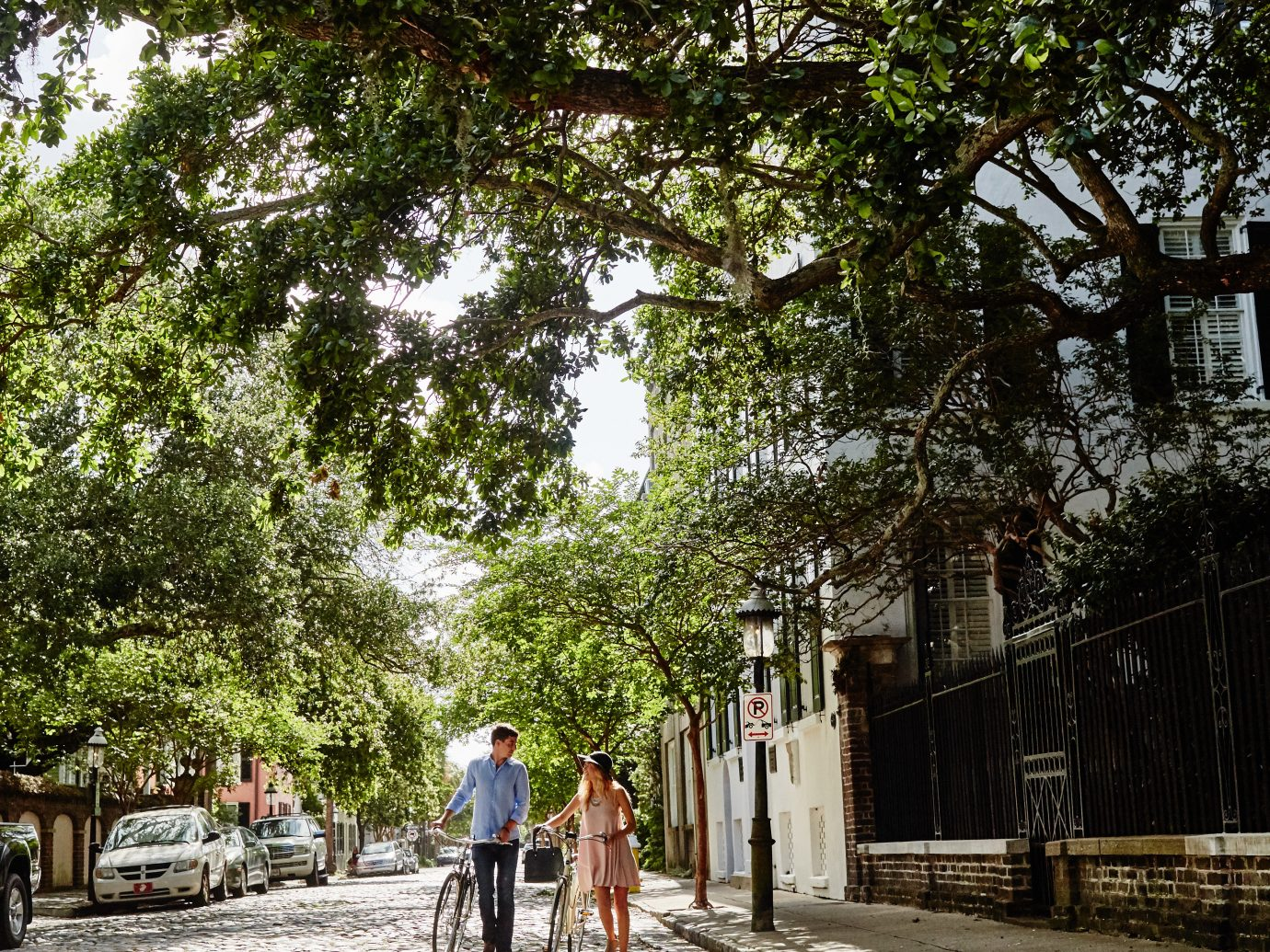 Hotels Romance tree outdoor ground neighbourhood Town road human settlement people woody plant tourism street park way Village sidewalk plant lined day