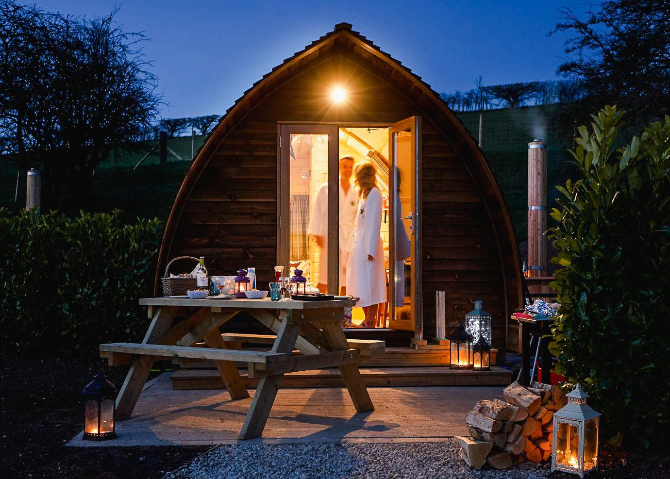 Glamping Outdoors + Adventure Trip Ideas tree outdoor home lighting house cottage evening log cabin shed landscape lighting real estate night outdoor structure hut