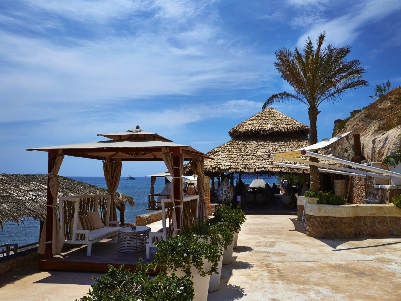 Trip Ideas sky outdoor Resort arecales palm tree Sea tree tropics vacation tourism Villa estate real estate Coast plant hacienda leisure water outdoor structure Beach stone