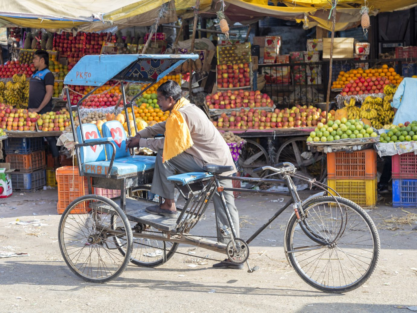 India Jaipur Jodhpur Trip Ideas bicycle outdoor land vehicle vendor public space marketplace mode of transport vehicle person street bicycle accessory market stall fruit rickshaw cart sports equipment bazaar recreation hawker hybrid bicycle City fresh past busy