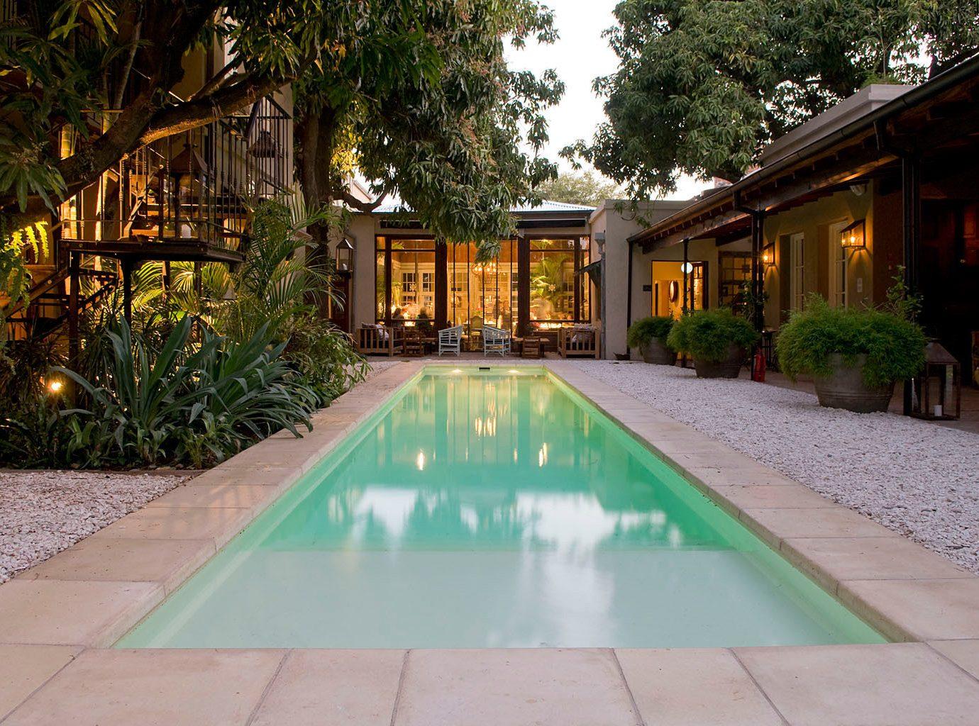 Hotels outdoor ground tree sidewalk swimming pool property estate green Resort Courtyard backyard home Villa real estate mansion hacienda yard way walkway curb