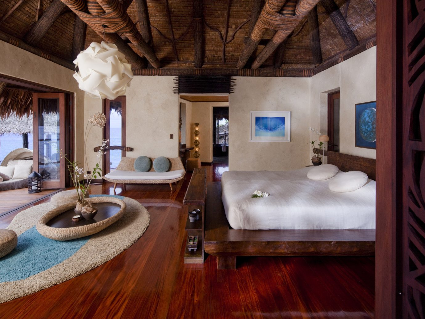 All-Inclusive Resorts Beach bed Bedroom Hotels hut isolation Luxury Luxury Travel open-air private quaint remote serene Tropical indoor room property estate house home cottage floor living room interior design farmhouse mansion Villa real estate Suite wood stone