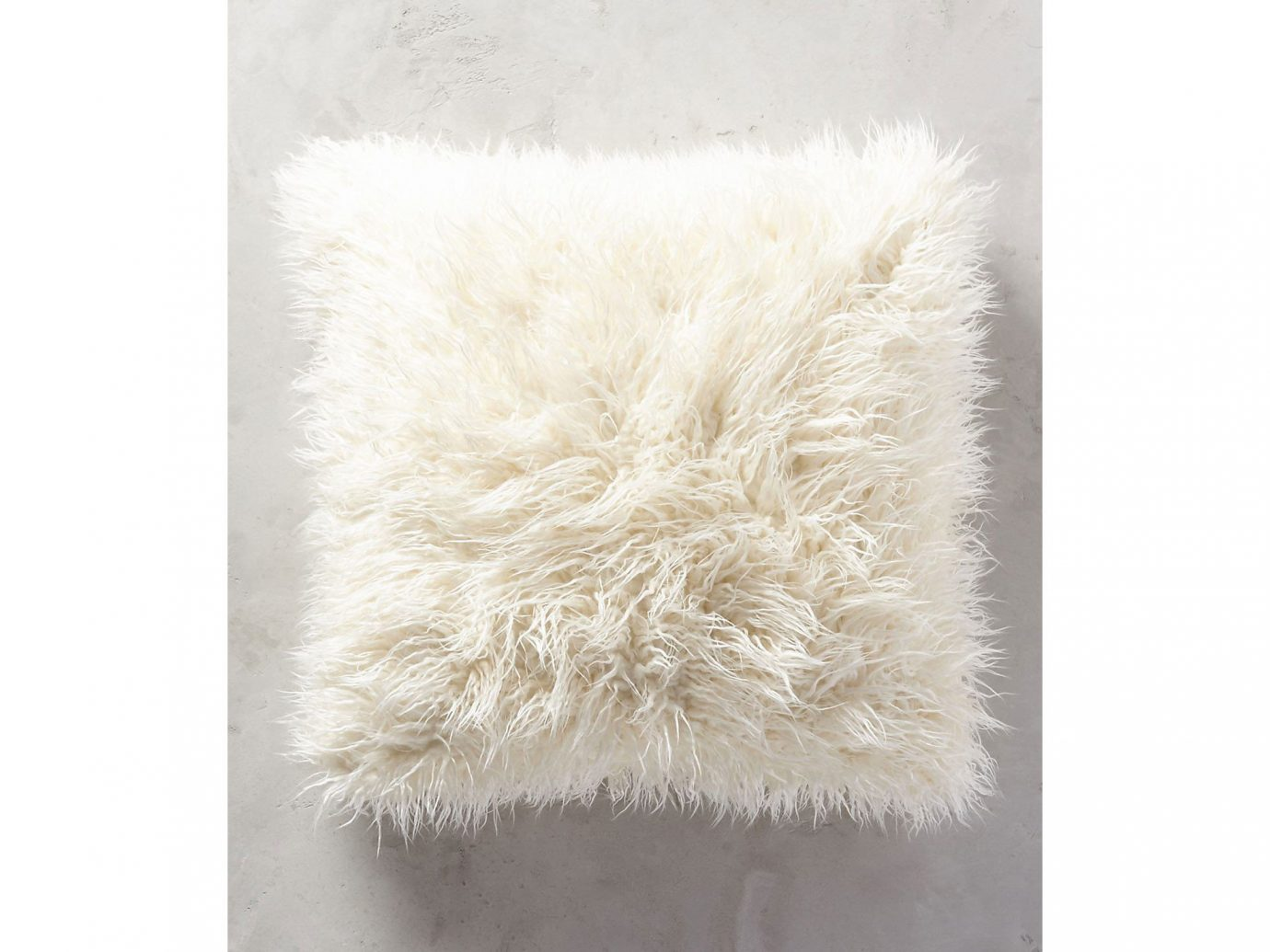 City Copenhagen Kyoto Marrakech Palm Springs Style + Design Travel Shop Tulum fur rug wool cushion feather pillow
